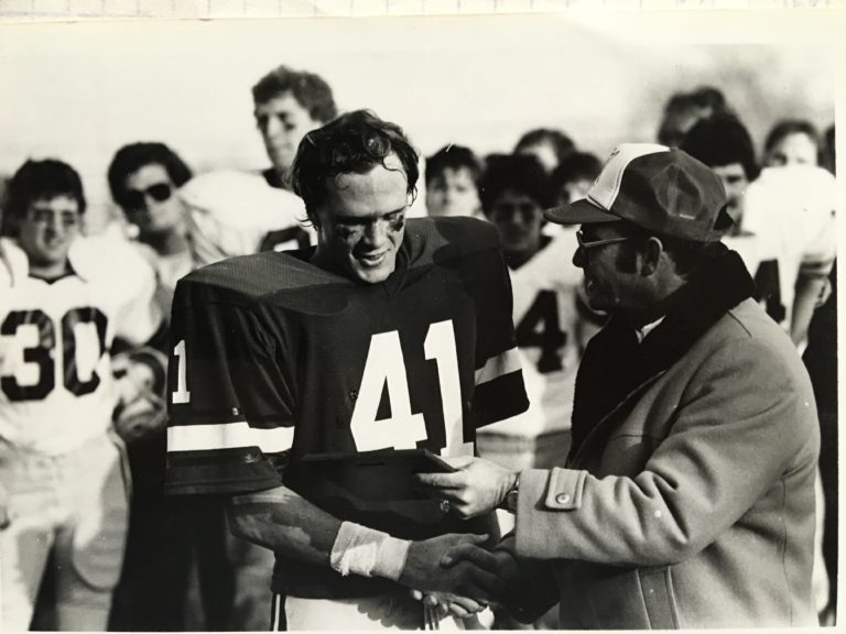 PT receiving the defensive award following the play-off, quarter final game against Pacific Lutheran in 1981